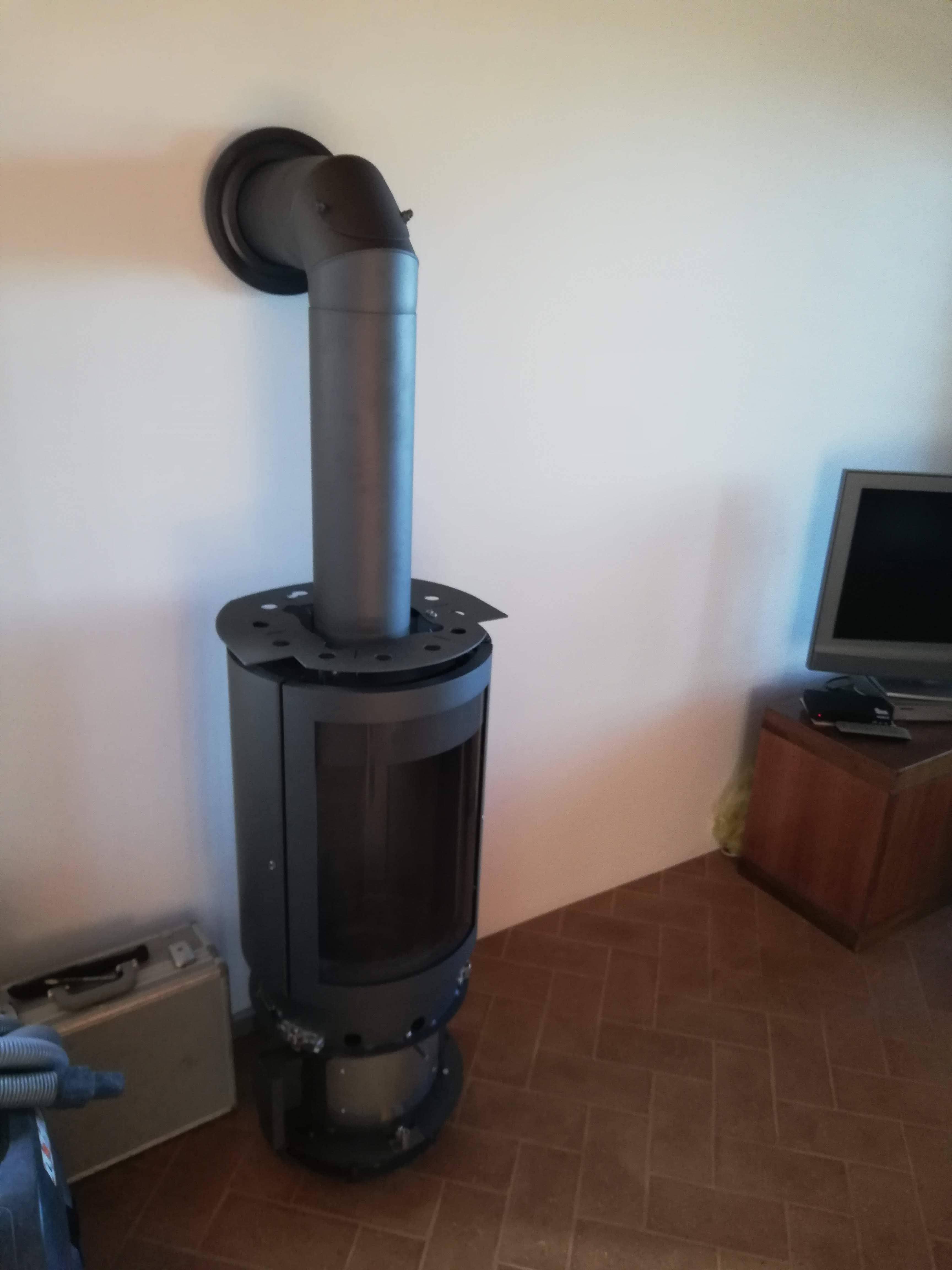 Applicazione del caminetto verticale a legna